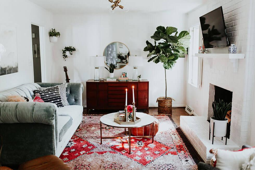 White living room with a red printed rug