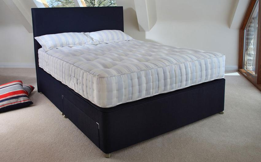Black divan bed with white mattress