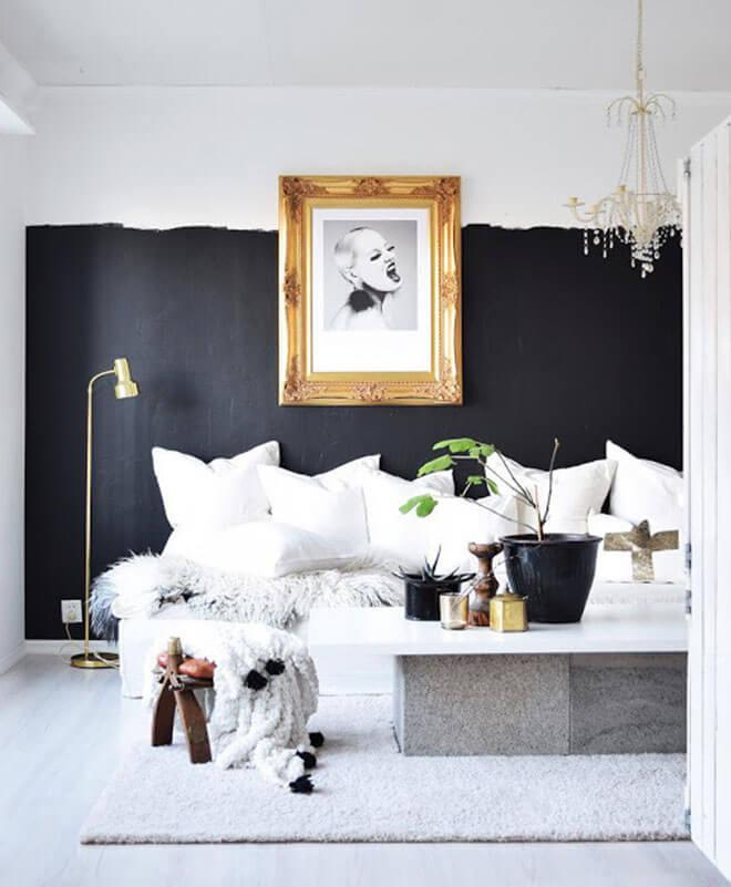 Bold black and white living space with gold frame.