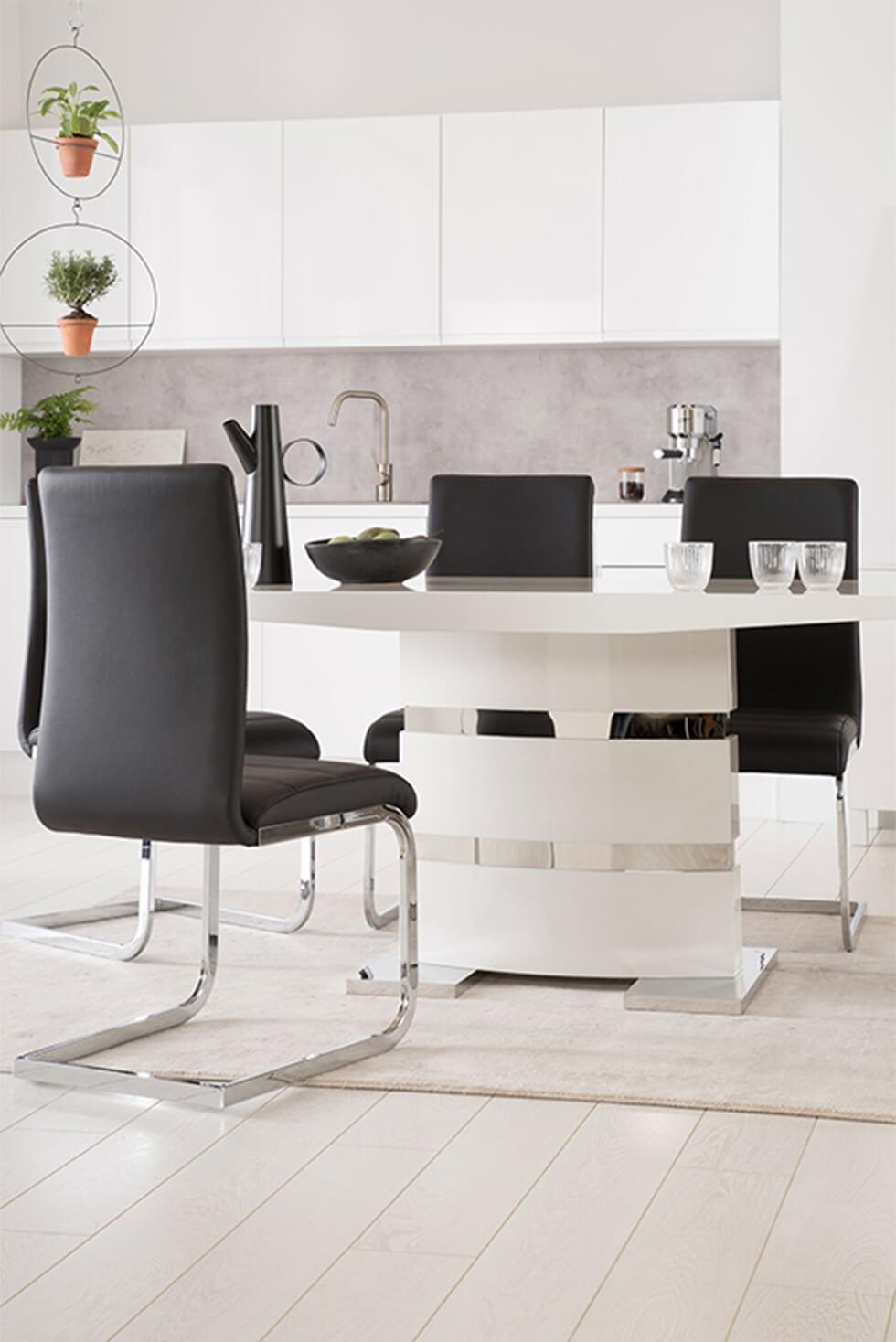 Modern living room with white high gloss table and black leather chairs with chrome legs