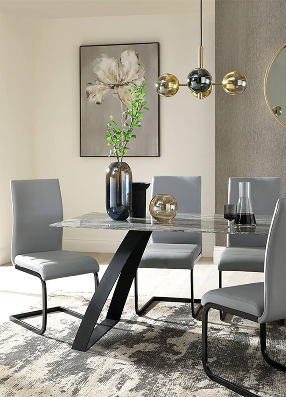 Dark neutral dining room with a marble dining table and grey leather dining chairs