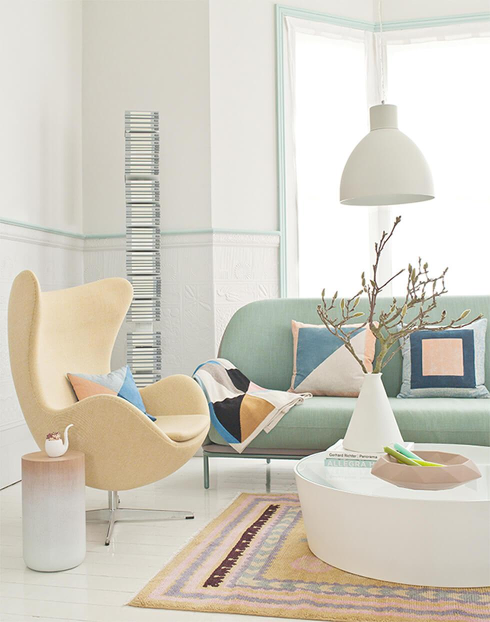 Pastel living room with mint green sofa and lemon yellow armchair