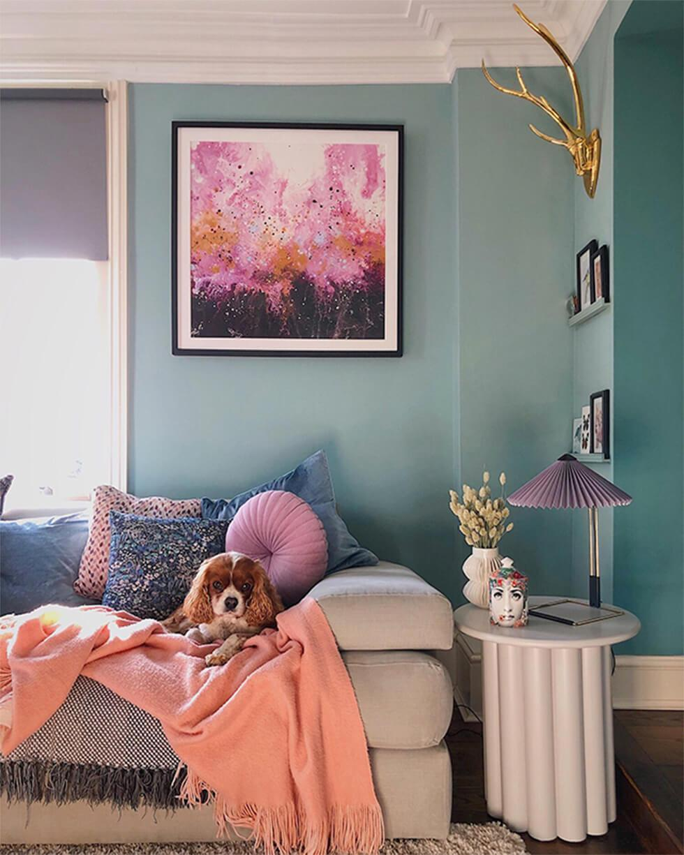 Teal and lilac living room with a neutral sofa and peach throw
