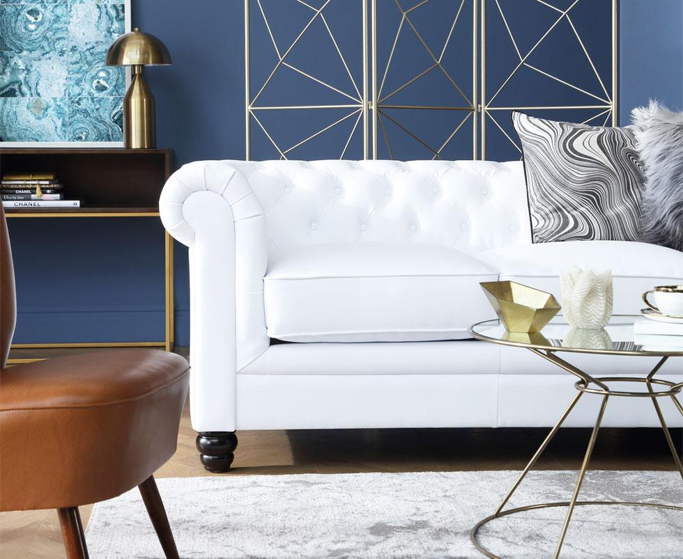 White sofa in a living room accented with gold decorations.