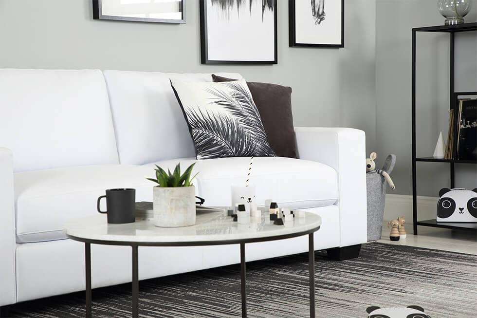 White sofa with black decorative elements..