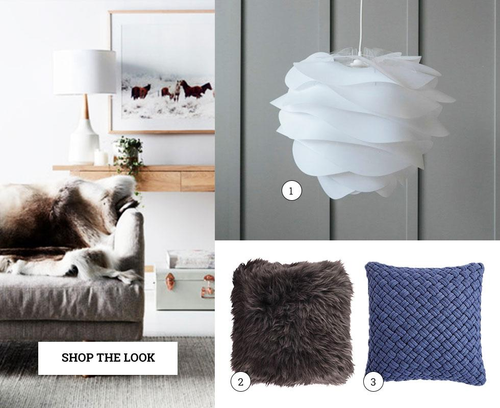 Scandinavian accessories including a sculptural lamp and cosy cushions.