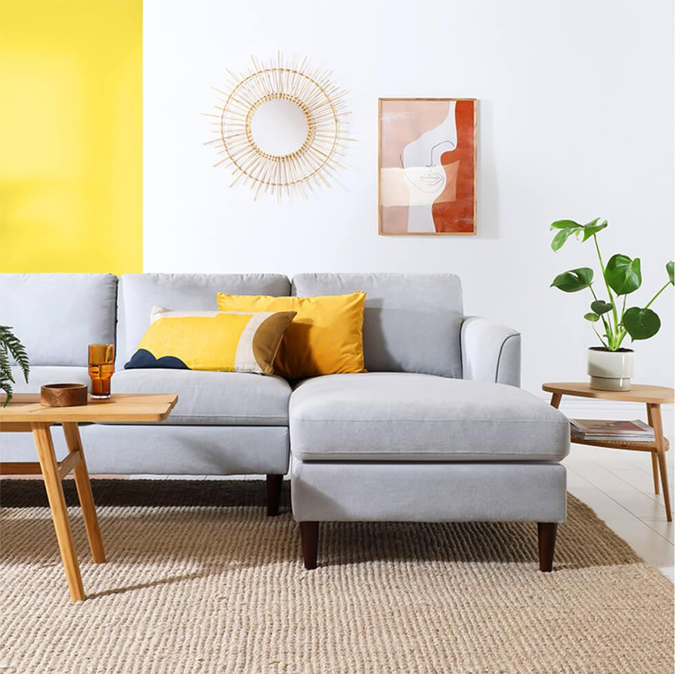 Grey sofa in yellow and white colour blocked living room