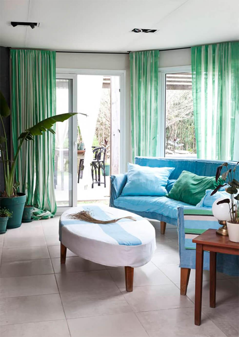 Refreshing south-facing living room with mint curtains