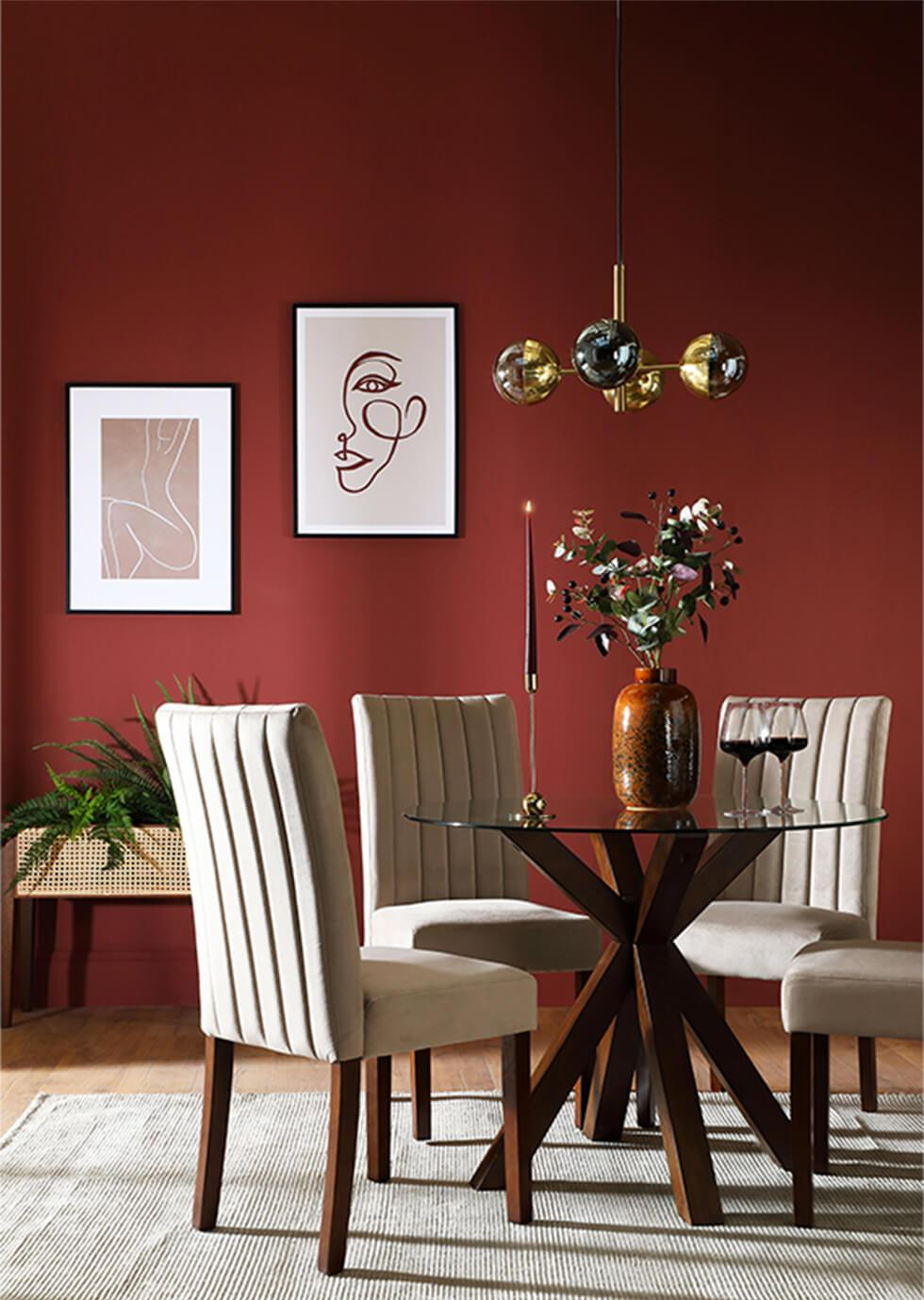 Red dining room with wooden dining table and fabric dining chairs