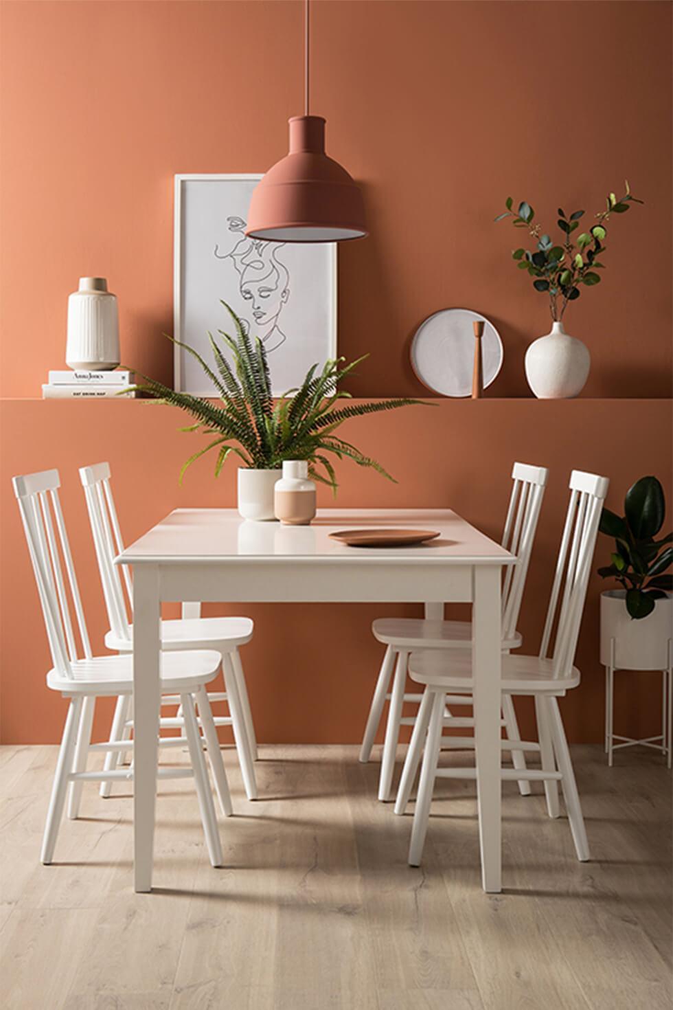 Orange dining room with white dining set