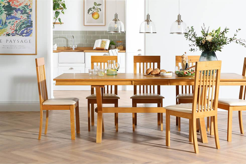 Oak dining set in an airy white dining room