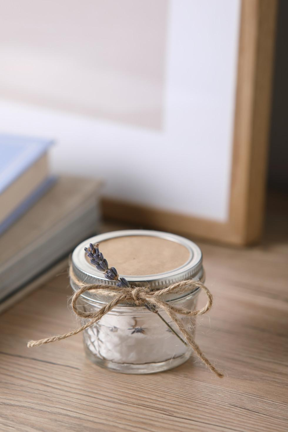 DIY natural air freshener in a mason jar tied with a sprig of lavender