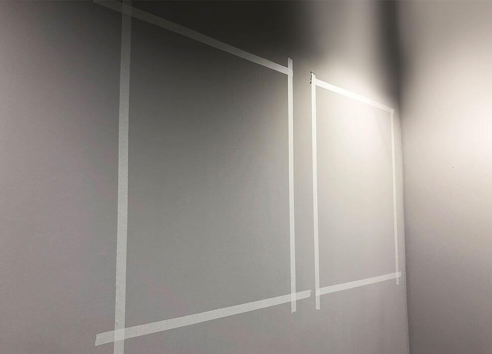 Masking tape on a grey wall.