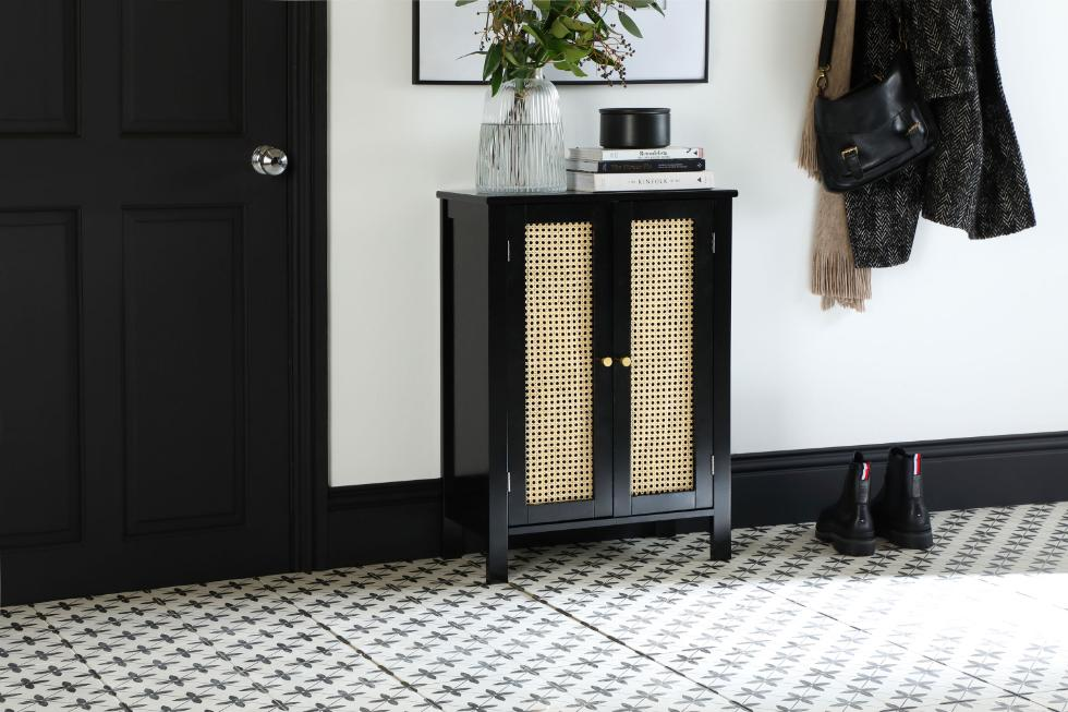 Rattan sideboard in a hallway with black and white tiles by Walls and Floors