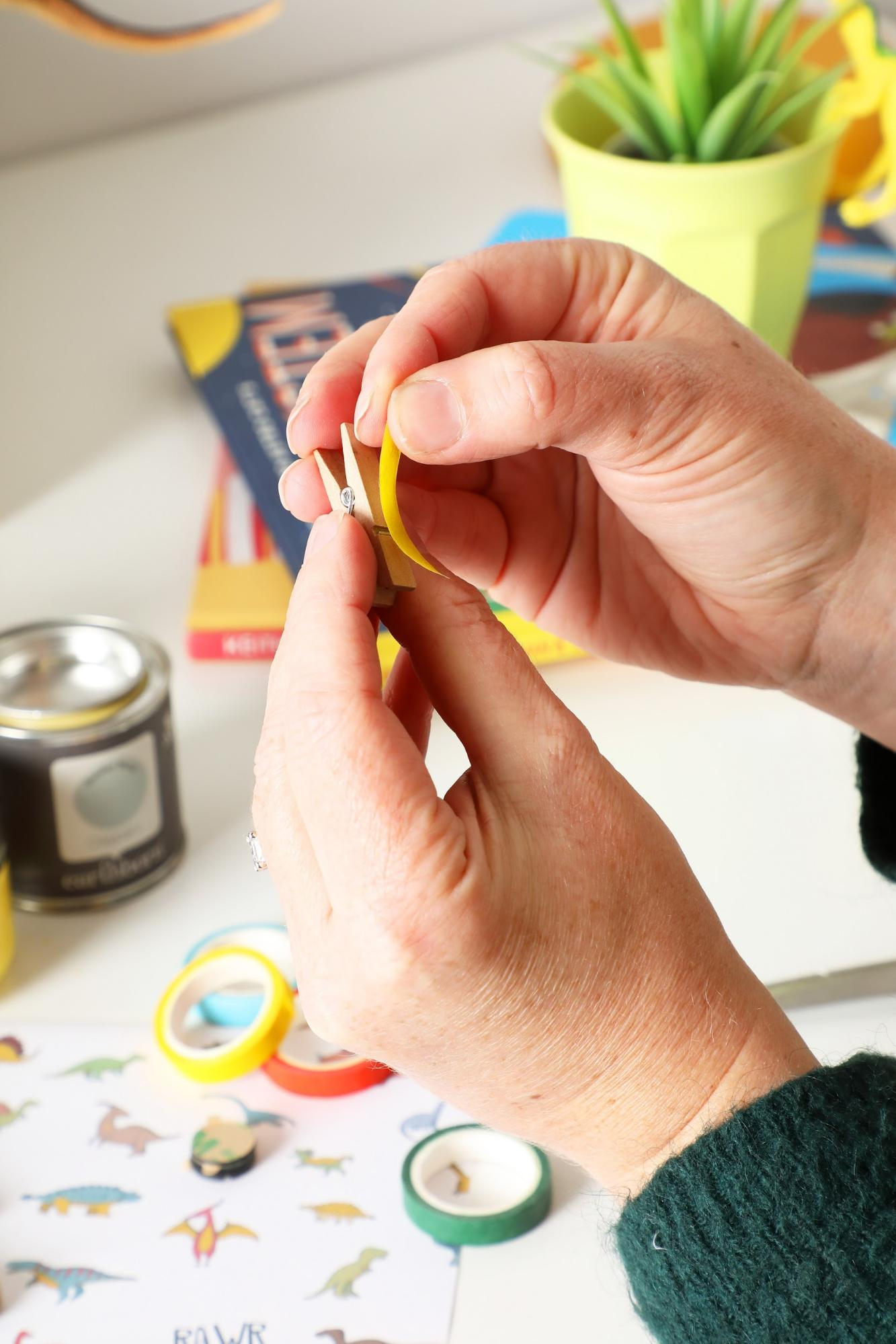 Covering craft pegs with washi tape