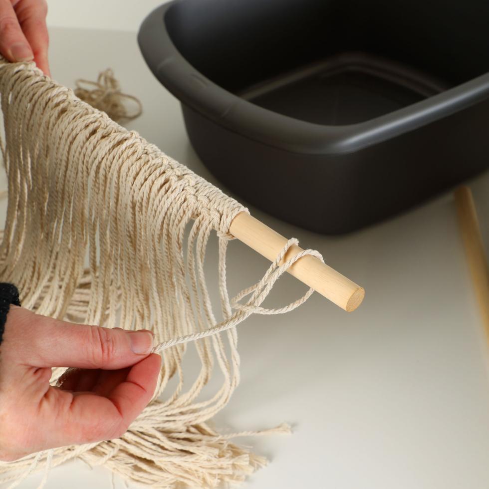 Step 1 - Looping the macrame string on the wood dowel