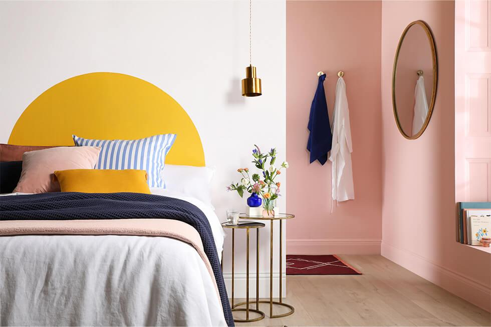 Bedroom with yellow arch feature wall and pink walls