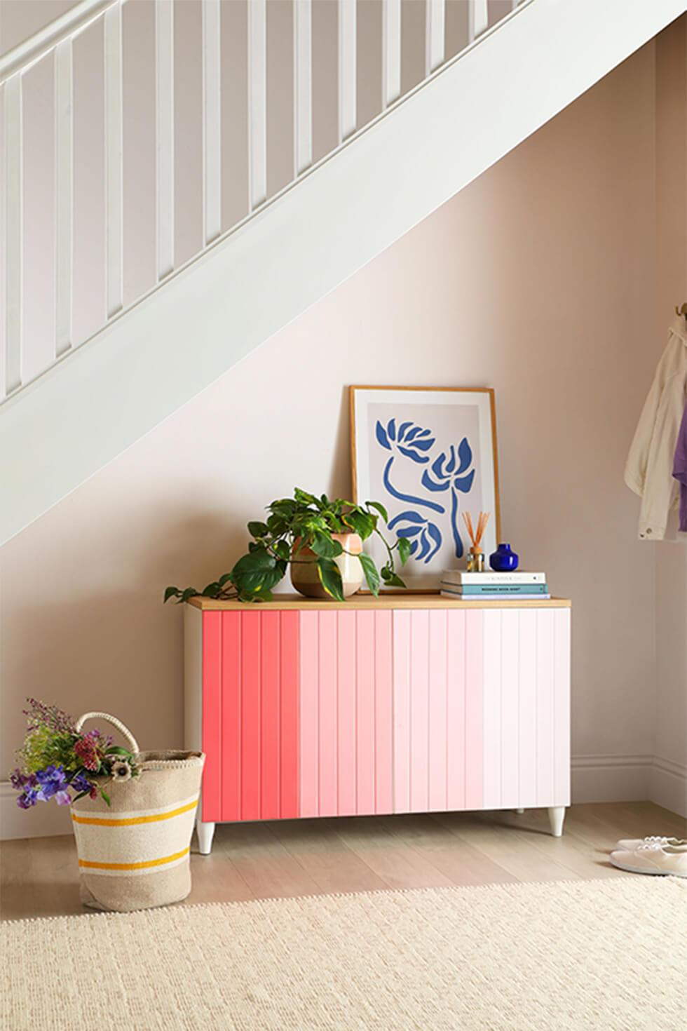 Completed pink diy ombre sideboard styled with plants and pantone ss21 colours