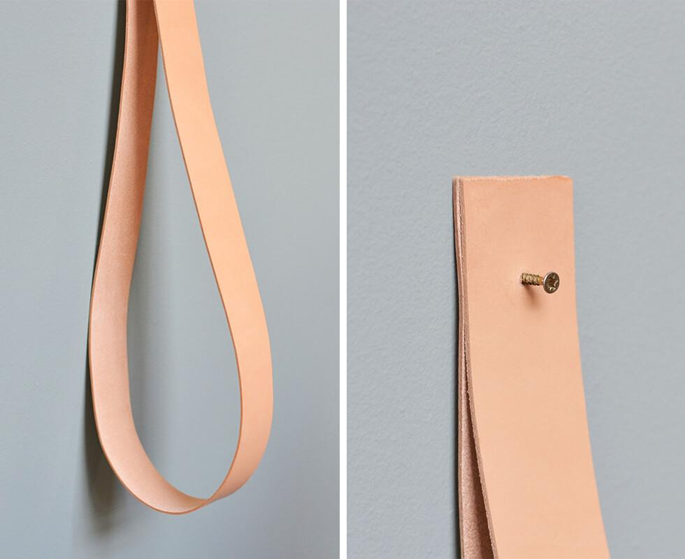Step 3 - fold one strap in half with the ends meeting and affix the screw through the strap into the wall