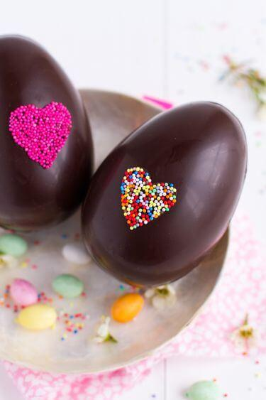 Chocolate eggs with assorted toppings.