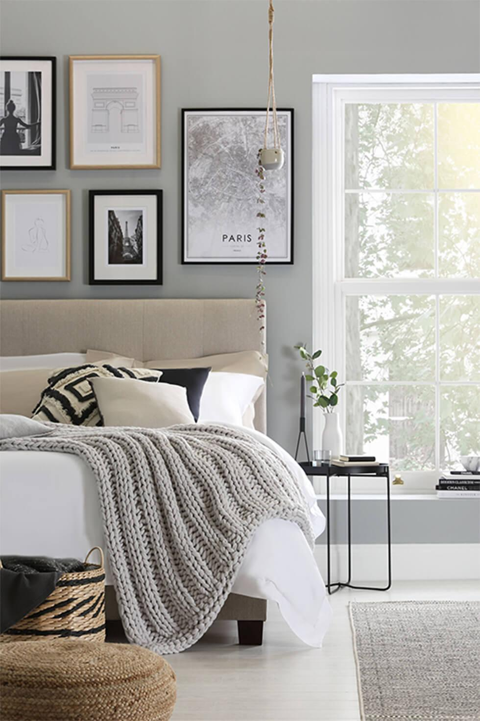 Monochrome bedroom with a framed gallery wall