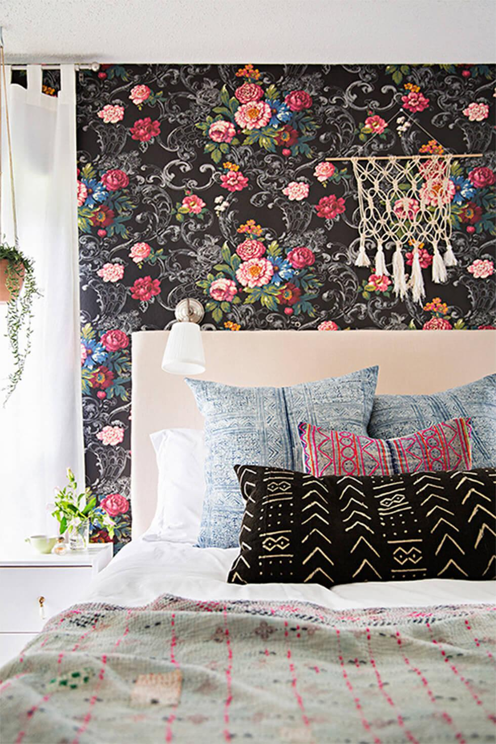 Bedroom with mixed print wallpaper and bedding