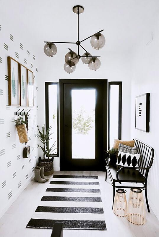 Black and white entryway with DIY paint feature wall