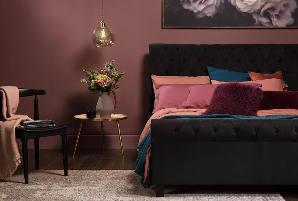 black velvet bed in a jewel toned bedroom