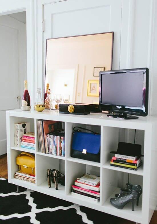 White shelf and a patterned rug.