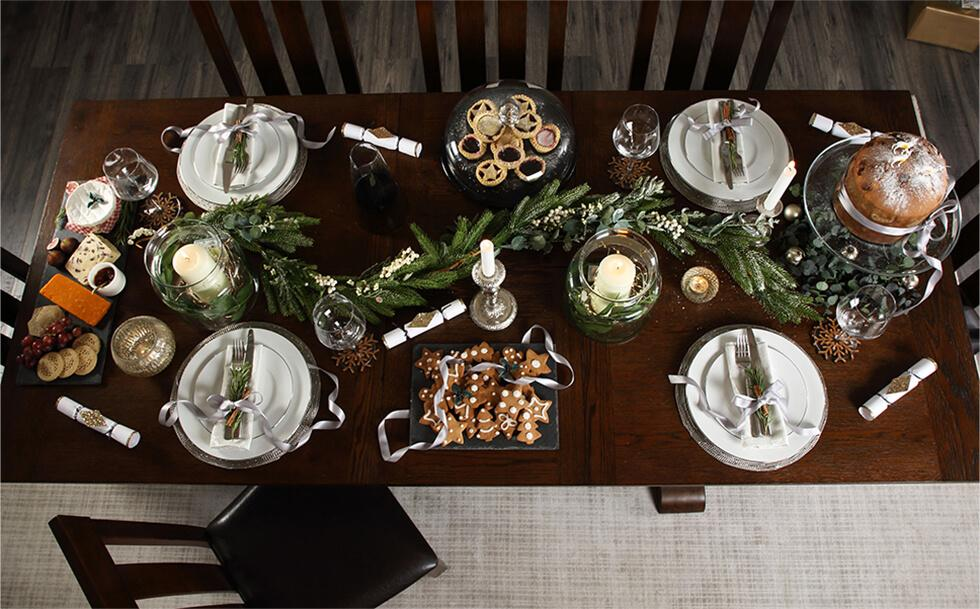 Christmas dinner table setting with candles and decorations