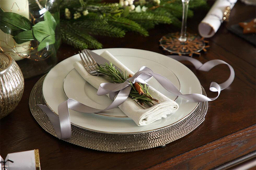 Close up of decor of christmas dinner table setting
