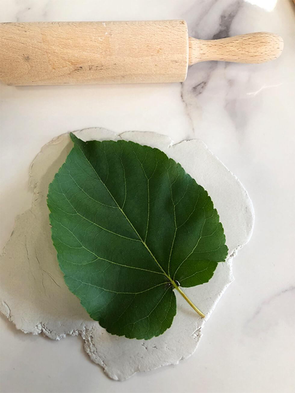 DIY leaf-shaped metallic trinket dish - Step 1 - roll out the clay and press a leaf firmly to imprint its veins