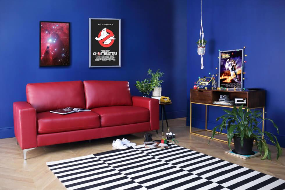 Stranger Things inspired living room with blue walls and red leather sofa