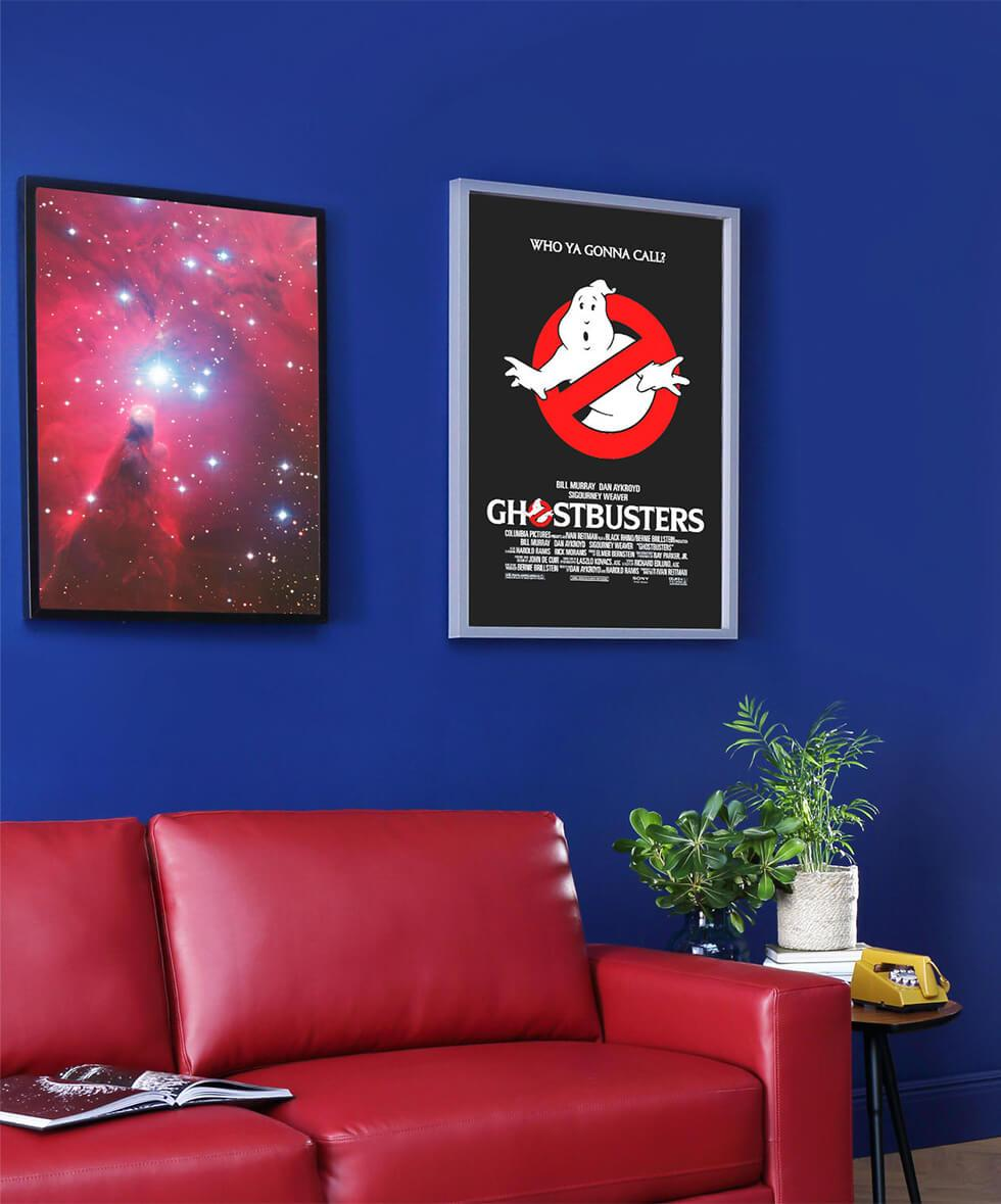 Stranger things inspired living room with blue walls, red leather sofa and Ghostbusters poster