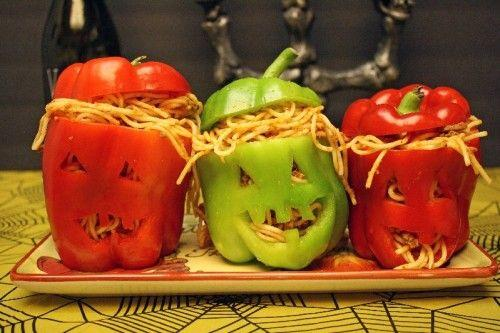 Spaghetti-stuffed bell-peppers with Halloween faces.