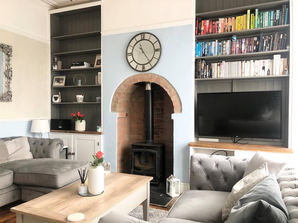 Living room with blue walls and traditional fireplace