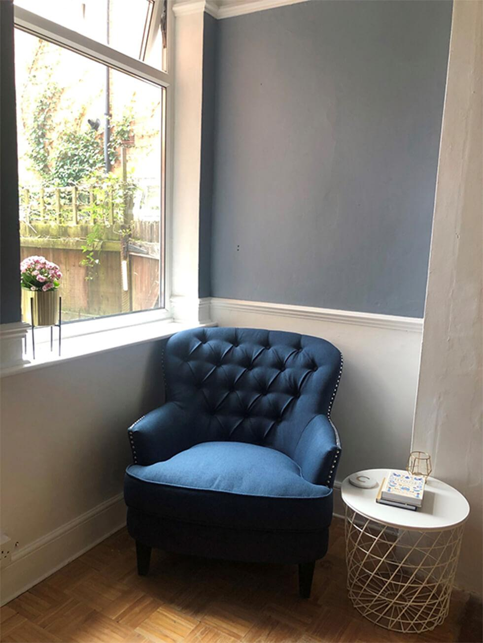 Relaxation corner with blue club chair