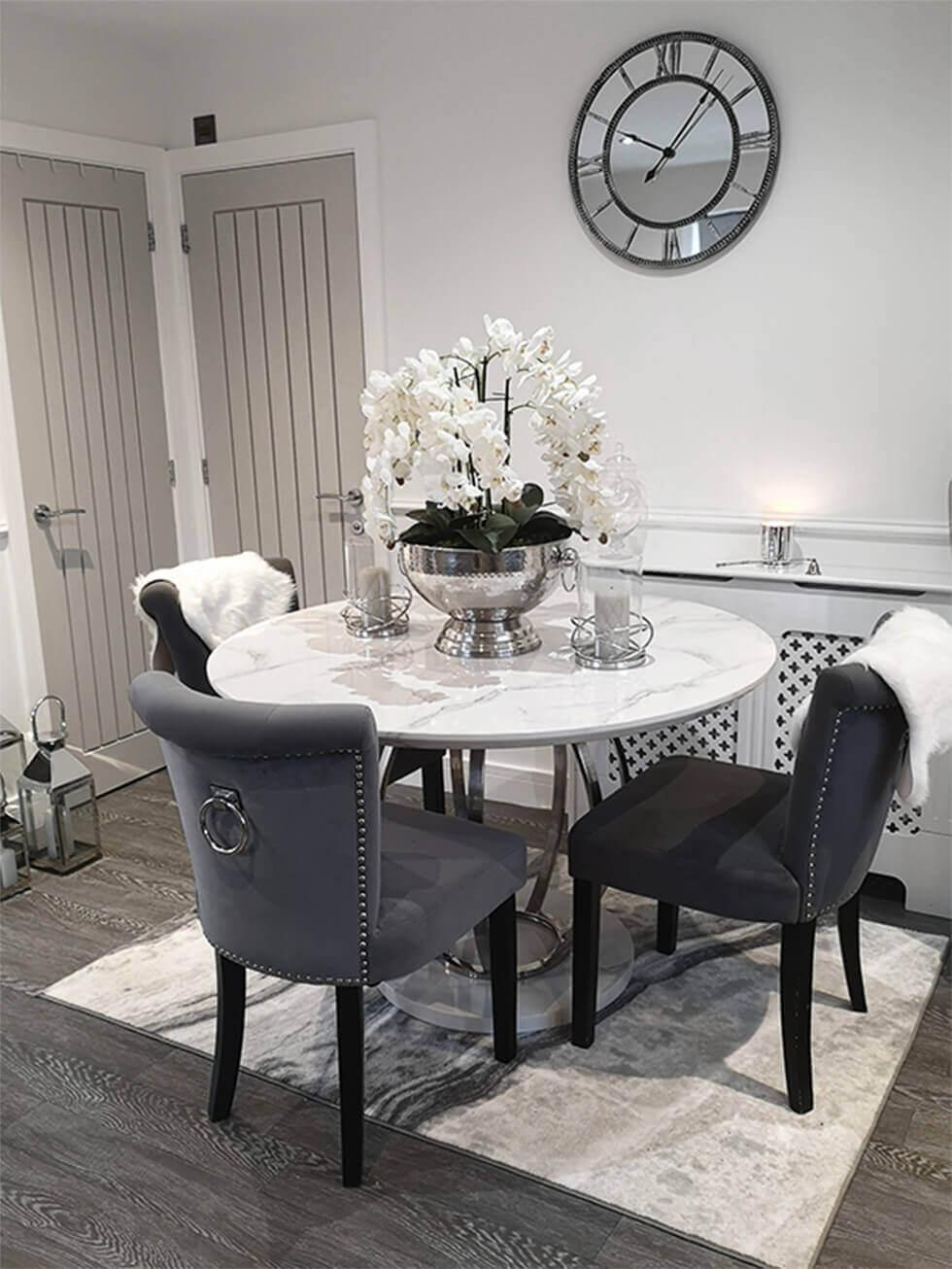 Dining room with a large faux orchid white centrepiece