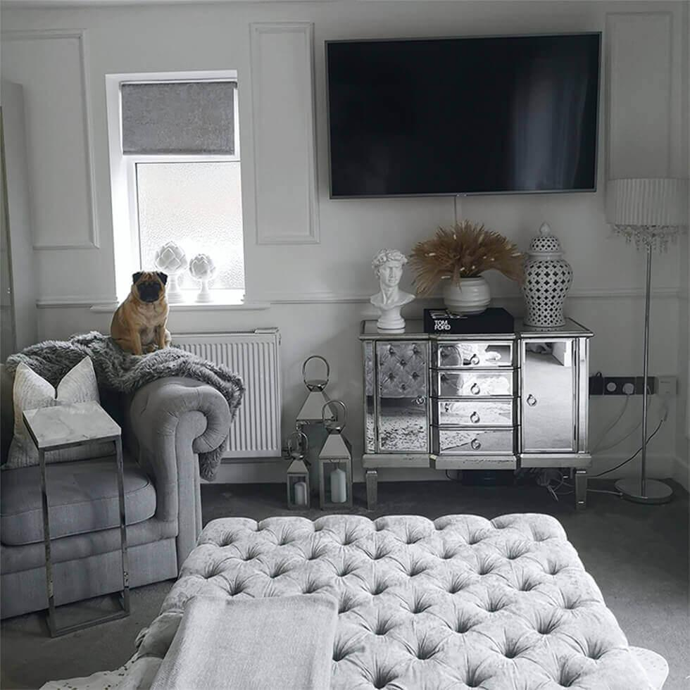 Grey living room featuring a mirrored sideboard
