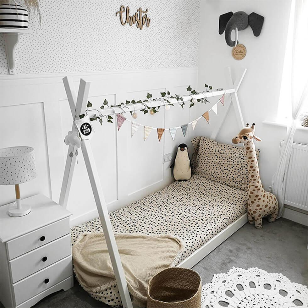 Playful children's bedroom with stuffed toys and animal print