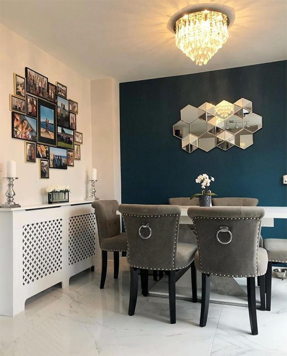 dining room with teal wall and grey dining chairs