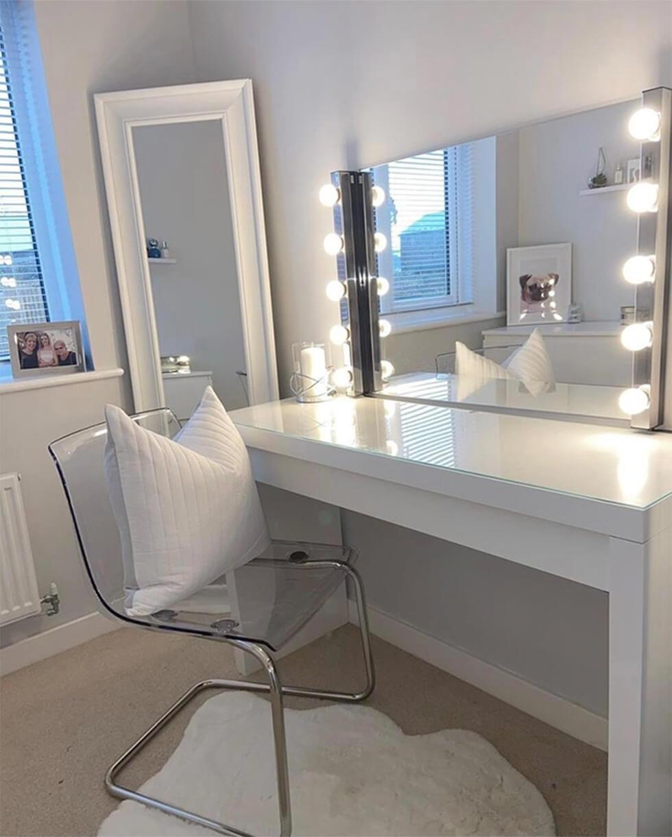 white makeup room with a big mirror and plastic chair
