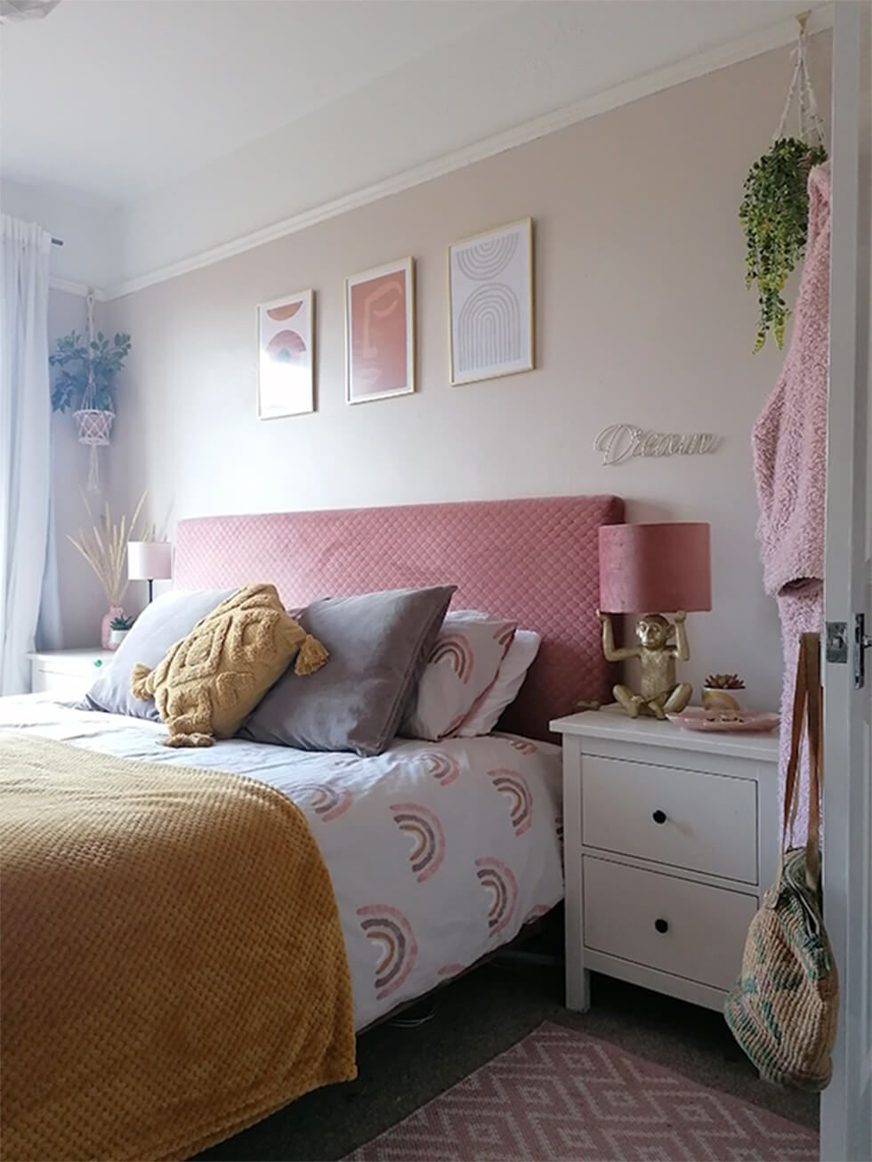 Bedroom with pink accents and hanging plants