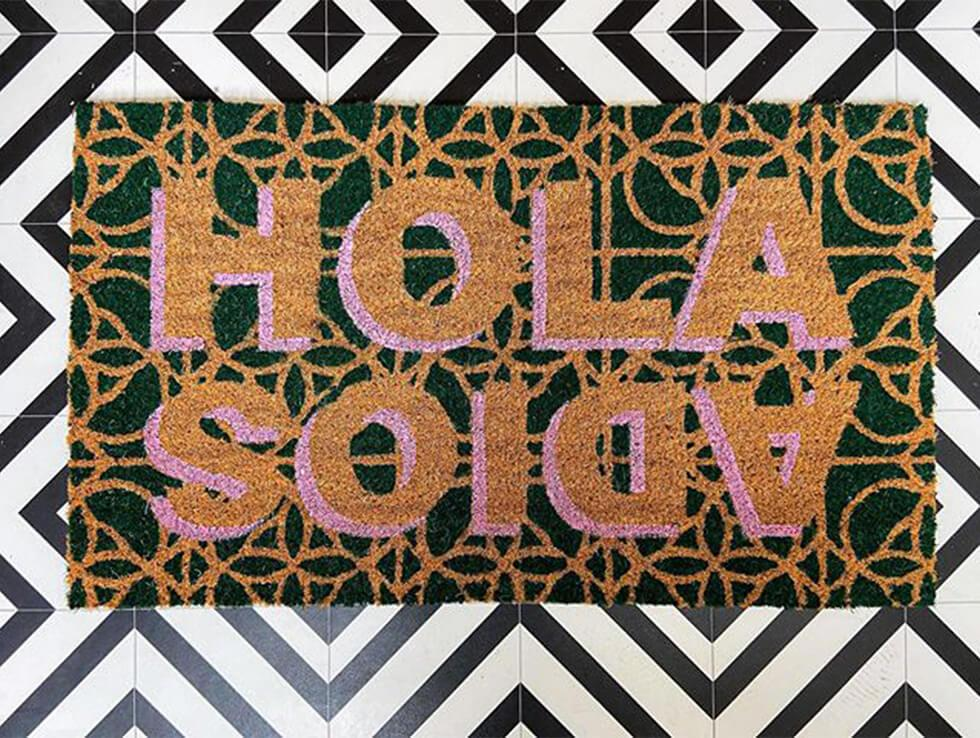 doormat that says hola and adios in a bold print