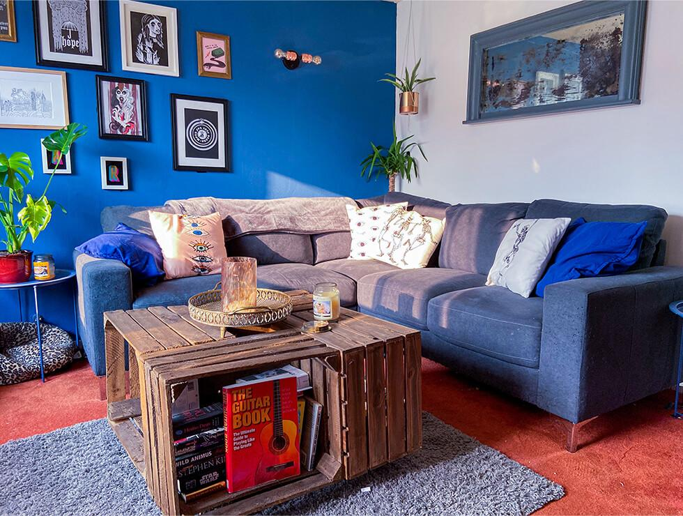 dark grey fabric corner sofa in a modern living room