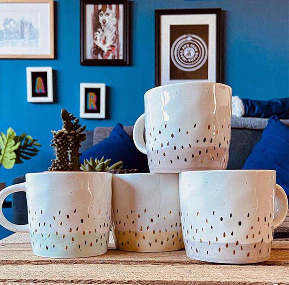ceramic patterned mugs in a blue living room