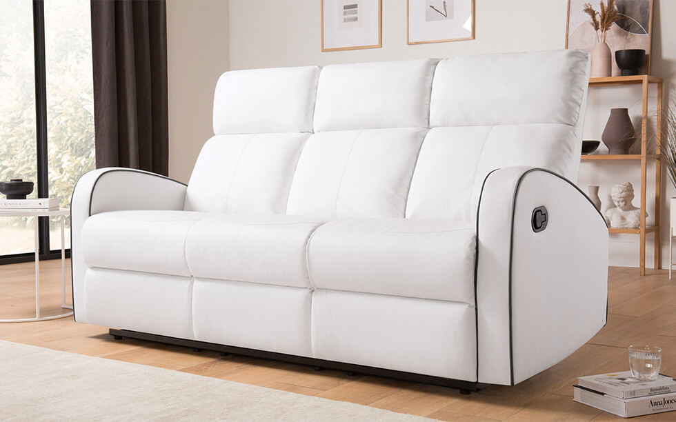 White leather recliner sofa in a modern white living room