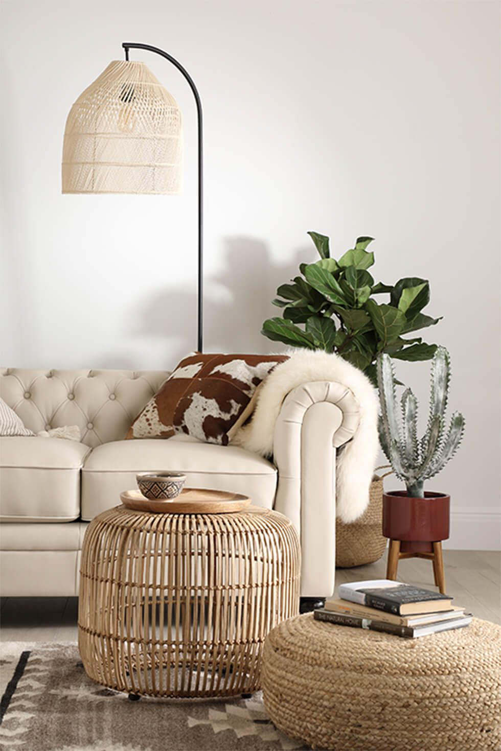 A relaxing living room with an ivory leather Chesterfield sofa and natural accessories