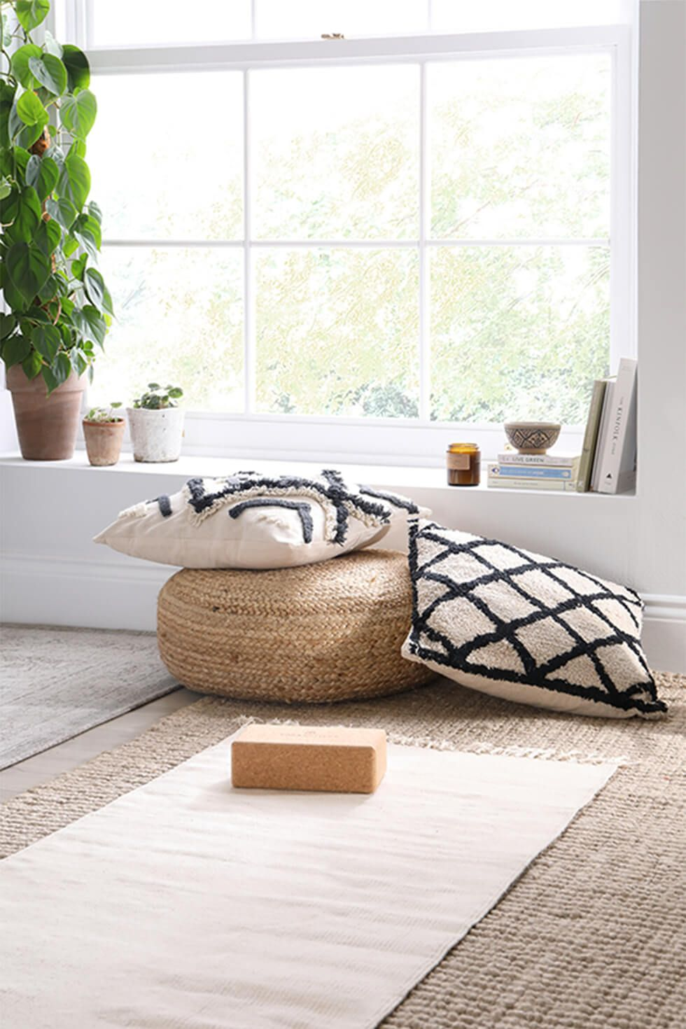 Relaxation nook with cushions and yoga accessories