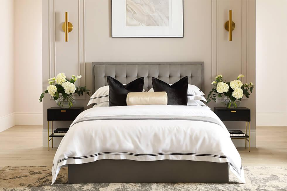 Luxe bed with grey headboard with in designer bedroom